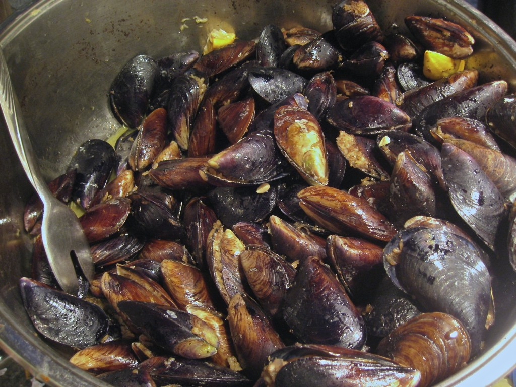 Mussels stuffed with rice, seasoned with cinnamon and topped with a ...
